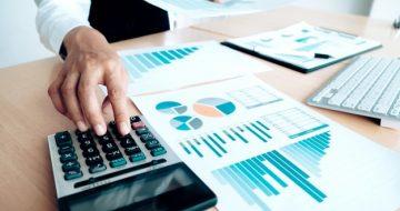 finances-saving-economy-concept-female-accountant-banker-use-calculator_1421-90