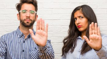young-indian-woman-caucasian-man-couple-serious-determined-putting-hand-front-stop-gesture-deny-concept_1187-15055